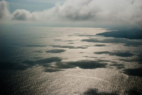 Clouds make shadows on the ocean between San Jose and Tambor, Costa Rica.