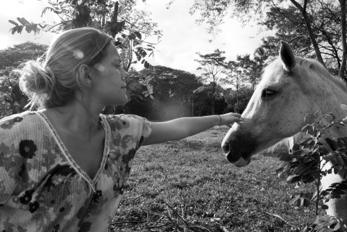 "Natalie petting a horse she named ""Princess"" near the airstrip in Tambor, Costa Rica."